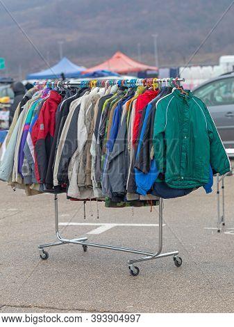 Winter Jackets Hanging On Rails At Flea Market