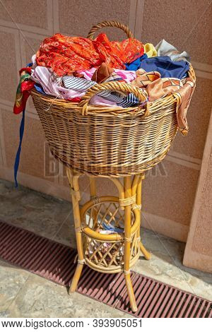 Colourful Shawls And Scarves In Big Rattan Basket