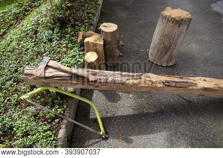 A Saw And And Ax Next To Wood