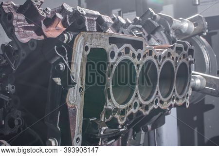 The Cylinder Block Of The Four-cylinder Engine. Disassembled Motor Vehicle For Repair. Parts In Engi