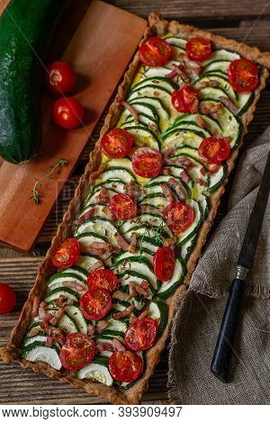 Healthy Whole Wheat Savoury Tart Quiche With Cherry Tomatoes, Bacon And Zucchini