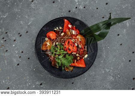 Beef Wok. Traditional Chinese Mongolian Beef Stir Fry In Chinese Cast Iron Wok With Cooking Chopstic