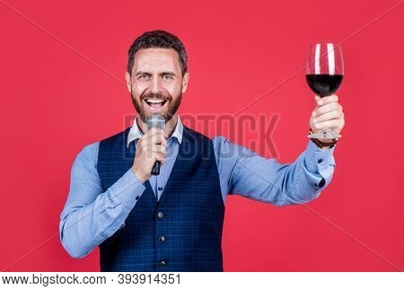 I Demand The Banquet Continue. Toastmaster Speak Into Microphone Lifting Glass Of Wine. Holding Banq