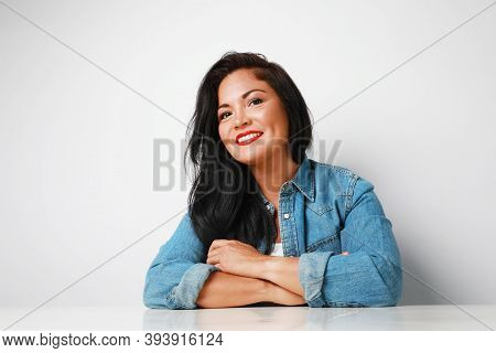 Headshot Of Positive Mature Woman Looking Aside, Wearing Denim Shirt, Smiling . Isolated On White Ba