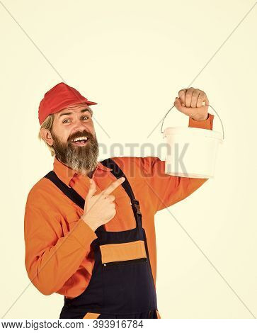 Apply Plaster In Order To Finish Interior Walls. Bearded Mature Man Painter. Wall Painter With Paint