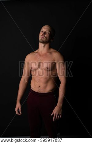 A Sports Guy Of Beautiful Strength Builds Muscles In Training. Strong Bodybuilder With Perfect Abs,