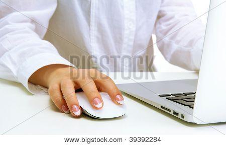 female hand writing on laptot, close up