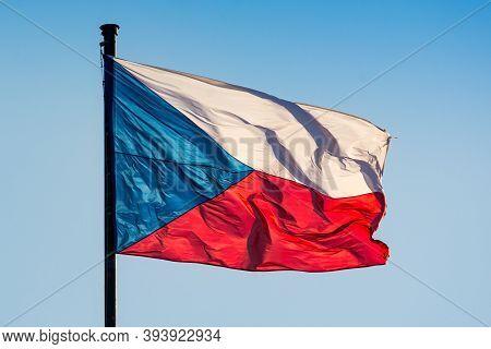 Prague, Czech Republic - September 19, 2020. Detail Of Flag Of Czechia Flying In The Wind On The Blu