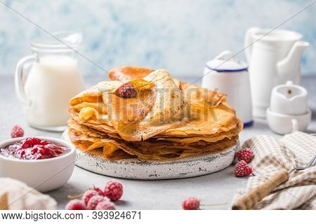 Homemade Recipe Of Thin Crepes (blini) For Breakfast Or Dessert.crepes With Berry In A Cast Iron Pan