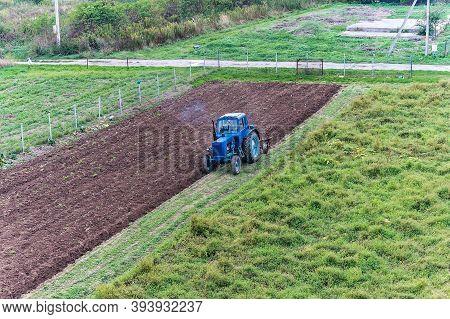 Fertilizing Fields, Blue Tractor Fertilizing A Field, Farmers Spreading Fertilizer With Shovels, Kal