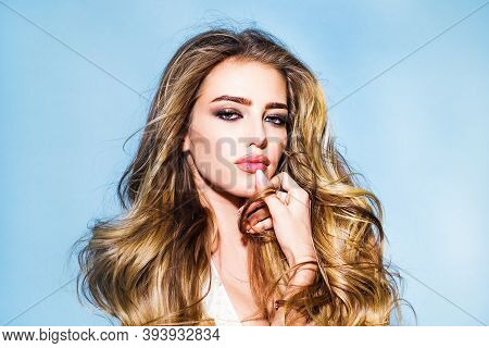Beautiful Girl With Long Wavy Hair. Beautiful Young Woman With Clean Fresh Skin. Portrait Of A Young