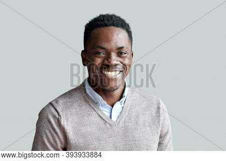Smiling Cheerful Young Adult African American Ethnicity Man Looking At Camera Standing At Home Offic