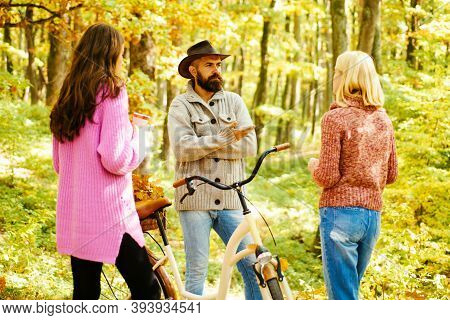 Happy Friends With Spending Time Outdoor In The Autumn Park. Enjoying Good Weather. Friends In Park