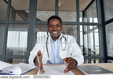 Happy African Male Doctor Talking To Camera During Telehealth Mobile Consultation. Black Physician C