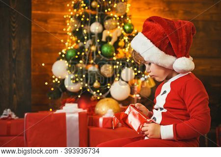 Family Holiday. Boy Cute Child Cheerful Mood Play Near Christmas Tree. Merry And Bright Christmas. L