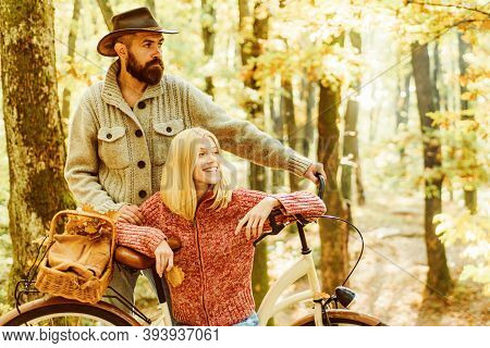 Autumn Date. Romantic Date With Bicycle. Bearded Man And Woman Relaxing In Autumn Forest. Romantic C