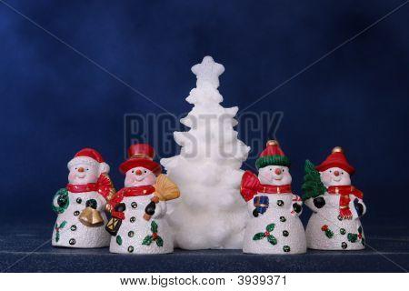 Four Snowmen And White Xmas Tree