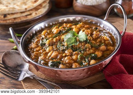 A Bowl Of Delicious Chickpea Curry With Spinach Channa Masala.
