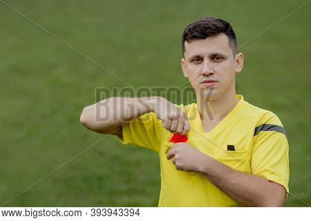 Referee Showing A Red Card To A Displeased Football Or Soccer Player While Gaming. Concept Of Sport,