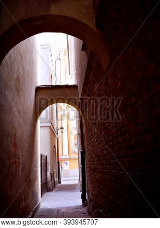 Alley In The Old Town In Warsaw, Gate Between Tenement Houses