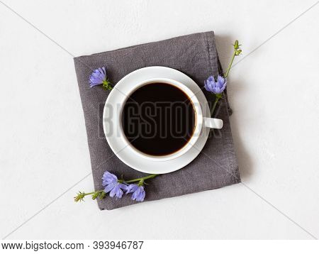Healthy Chicory Drink And Blue Flowers On A Gray Napkin. Herbal Coffee Substitute. Chicory Beverage