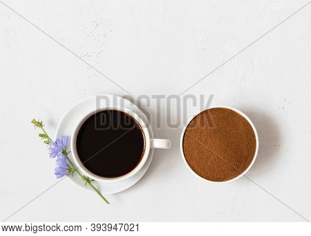 Cup With Chicory Drink And Chicory Powder On A White Background Closeup. Natural Healthy Coffee Subs