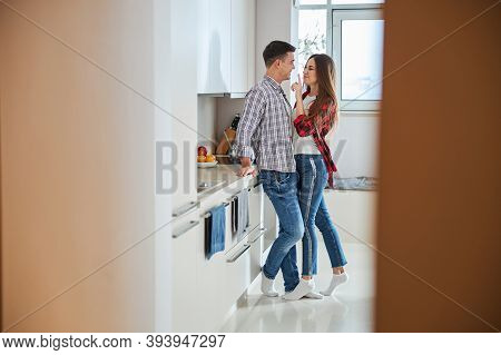 Mischievous Woman Teasing Her Husband In The Kitchen