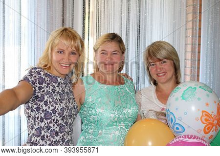 Chernihiv / Ukraine. 27 August 2016:  Sisters Congratulate Their Younger Sister With Birthday. Three