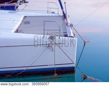 View Of The Rear Of A White Yacht Moored In The Sea