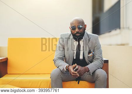 A Portrait Of A Fashionable Handsome Mature Bald Black Guy With A Beard And In An Elegant Plaid Cost