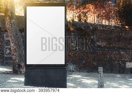 A Template Of An Empty Vertical Advert Banner With A Stone Wall Behind; The Mockup Of A Blank Advert