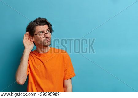 Photo Of Curious Man Keeps Hand Near Ear And Listens Private Information, Tries To Overhear Gossipin