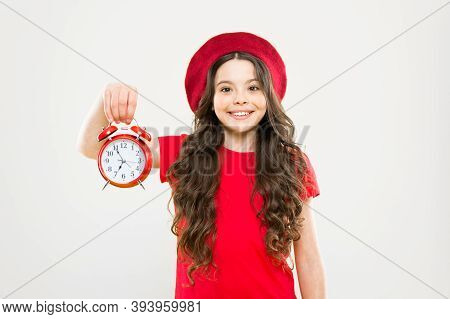 Time. Little Girl In French Style Hat. Happy Girl With Long Curly Hair In Beret. Beauty Hairdresser.