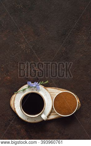 Chicory Drink And Ground Chicory Root On A Brown Background. Healthy Beverage. Vertical Orientation.
