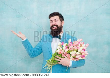 Flower Bouquet For Womens Day. Bearded Man With Tulips. Flowers Shop. Ideas To Celebrate Without Bre