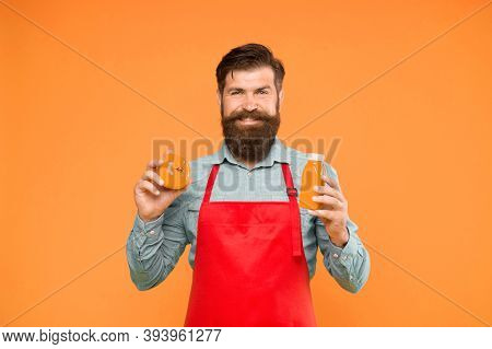 Tomato Juice Is Highly Nutritious. Brutal Cook In Apron Drinking Tomato Juice. Bearded Man Chef With