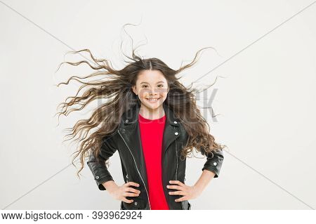 Hairdresser Is A Girls Best Friend. Cute Little Girl With Long Wavy Hair Happy Smiling On Yellow Bac