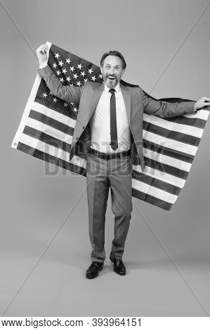 Liberty And Justice For All. Patriotic Businessman Hold American Flag. Happy Man Celebrate Independe