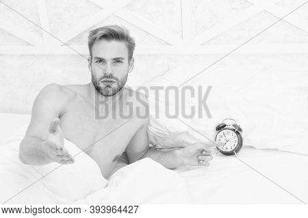 Alarm Clock Went Off. Sleepy Guy Point Finger At Alarm Clock. Sexy Man Awake In Bed. Turn Off Alarm.
