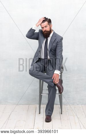 Hair Cut For Every Style. Bearded Man Touch Hipster Hair. Unshaven Businessman In Formalwear Sit On
