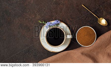 Composition Of Chicory Drink, Chicory Powder, Napkins And Spoon On A Brown Background. Healthy Chico
