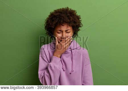 Emotional Burnout. Depressed Miserable Woman Sobs And Whins From Despair, Has Serious Problem, Canno