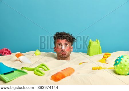 Displeased Man Looks Above On Sky With Sad Expression, Hates Heat, Got Sunburn, Has Head Stick Out F