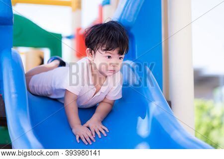 Little Boy Play The Blue Slider On A Hot Day. Children Face Down The Player. Adorable Little Baby Bo