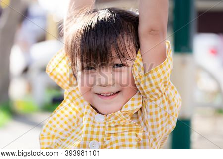 Portrait Of Asian Cute Girl Raise Their Arms, Exercise, Sweet Smile. Children Are Cheerful. Happy Ch