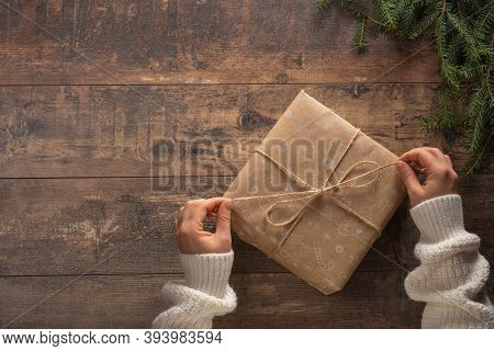 Christmas Gift. Congratulations.top View Of Woman Holding Traditional Decorated Gift Box. Hands Hold