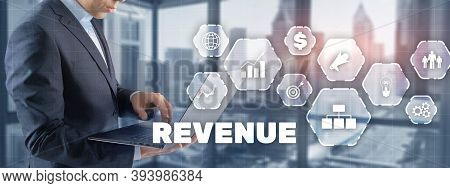 Increase Revenue Concept. Businessman Pressing Inscription Revenue.
