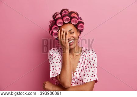 Happy Carefree Woman Makes Face Palm And Giggles Positively, Being In Good Mood, Dressed Casually, T
