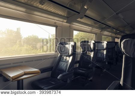 First-class Train Interior With Empty Seats, In Motion, On Sunny Day. Passenger Train, A German Inte