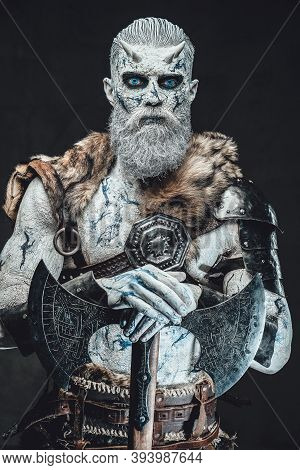Pale Skinned Northern Undead Chief With Blue Eyes And Dark Armour With Fur Holds His Huge Axe With H